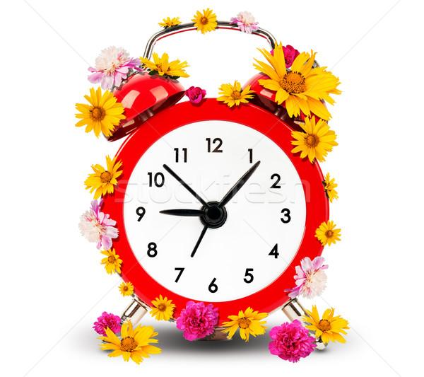 Alarm clock with flowers Stock photo © cherezoff