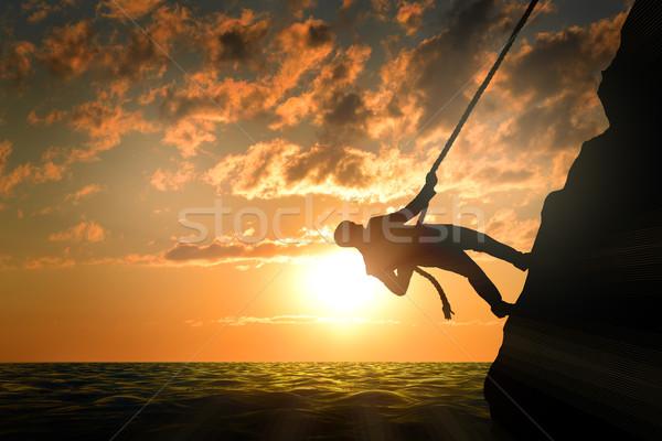 Business man climbs mountain Stock photo © cherezoff