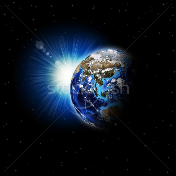 Earth planet in sun rays Stock photo © cherezoff