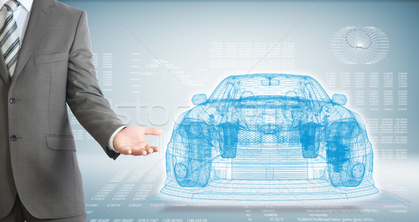 Businessman points hand on wire frame car Stock photo © cherezoff