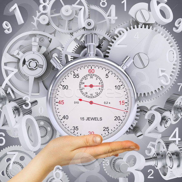 Hand hold stopwatch with figures and gears Stock photo © cherezoff