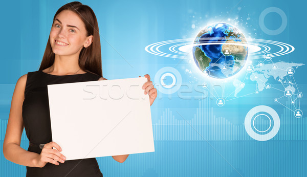 Beautiful businesswoman holding paper holder. Earth with network and graphs Stock photo © cherezoff