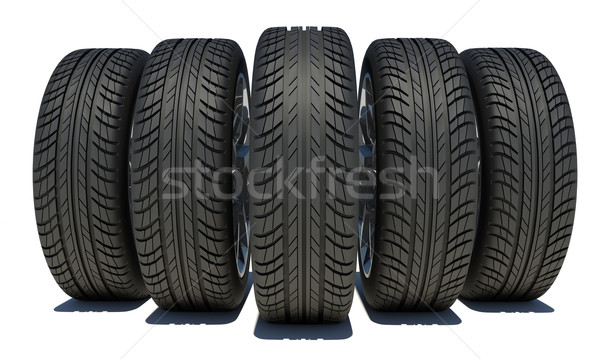 Wedge of five car wheels. Isolated on white background Stock photo © cherezoff