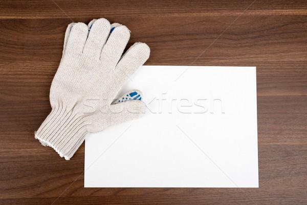Boş kart eldiven ahşap masa kâğıt kart beyaz Stok fotoğraf © cherezoff