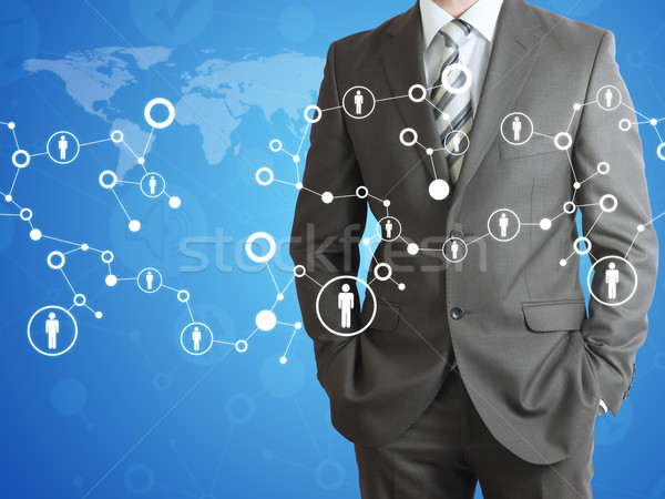 Businessman with world map and contacts Stock photo © cherezoff