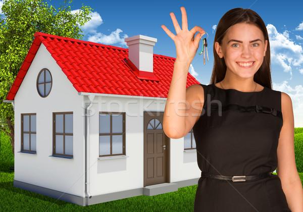 Beautiful woman holding keys Stock photo © cherezoff
