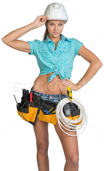 Woman in hard hat and tool belt posing Stock photo © cherezoff
