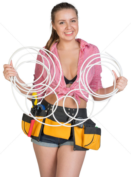Woman in tool belt holding coils of cable Stock photo © cherezoff