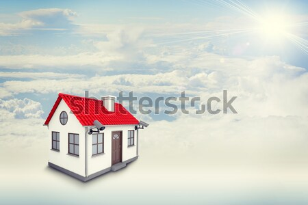 White house with label for rent, red roof and chimney in clouds. Background sun shines brightly Stock photo © cherezoff