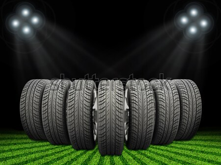 Wedge of new car wheels on road fork  and green grass field Stock photo © cherezoff