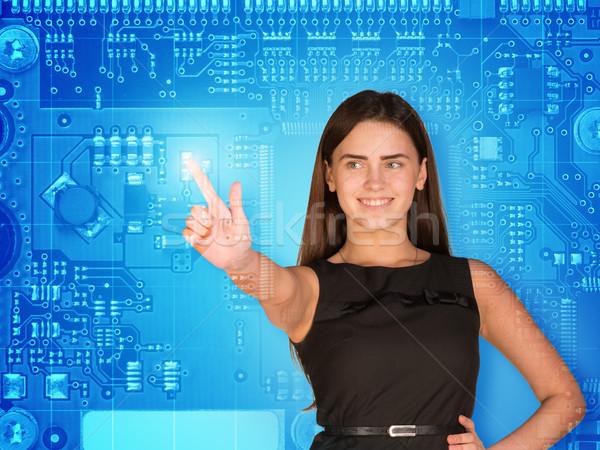 üzletasszony kisajtolás holografikus képernyő néz ujj Stock fotó © cherezoff