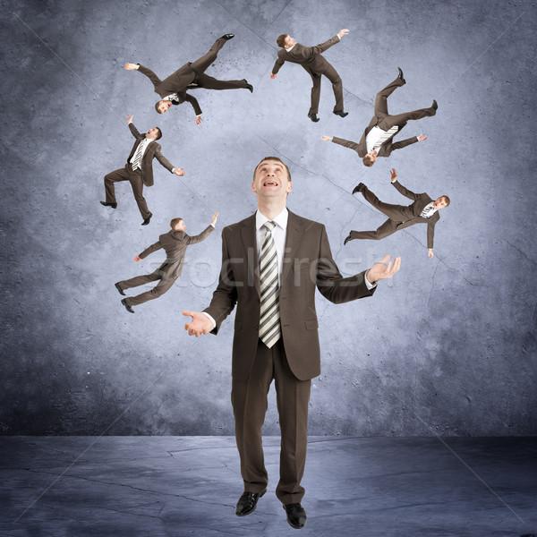 üzletember zsonglőrködés kicsi emberek absztrakt szürke Stock fotó © cherezoff