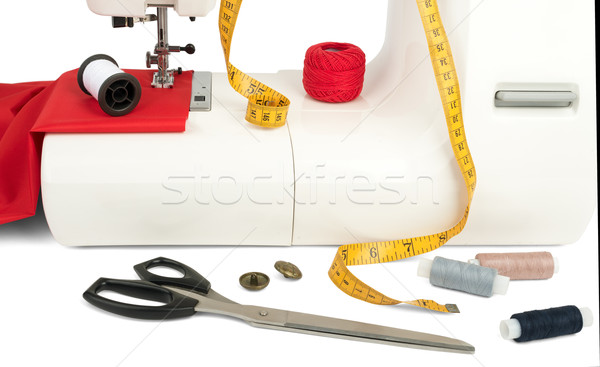 Sewing machine with fabric, threads and tape Stock photo © cherezoff