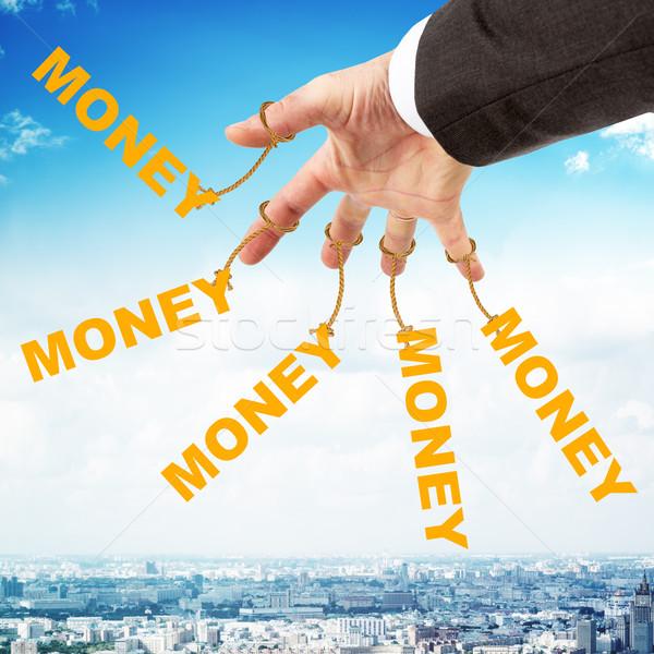 Szó pénz akasztás ahogy marionett fotózás Stock fotó © cherezoff