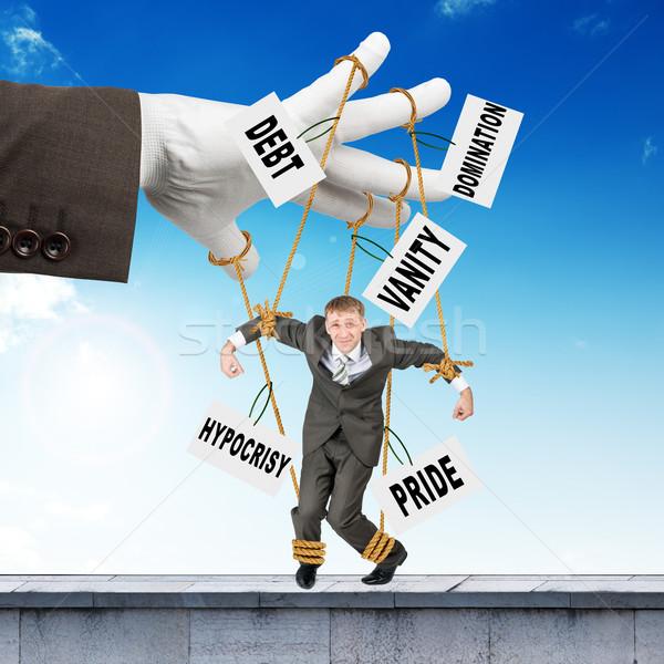 бизнесмен подвесной подобно марионетка изображение слов Сток-фото © cherezoff
