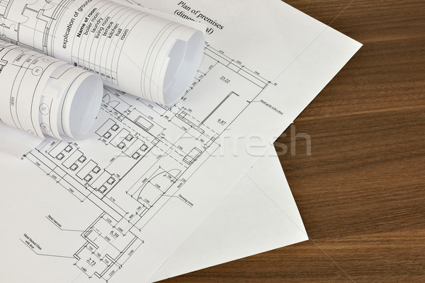 Construction drawings on a wooden surface Stock photo © cherezoff