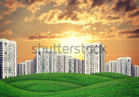 high-rise buildings over green hills Stock photo © cherezoff