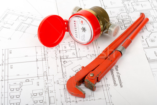 Water meter with wrench on draft Stock photo © cherezoff