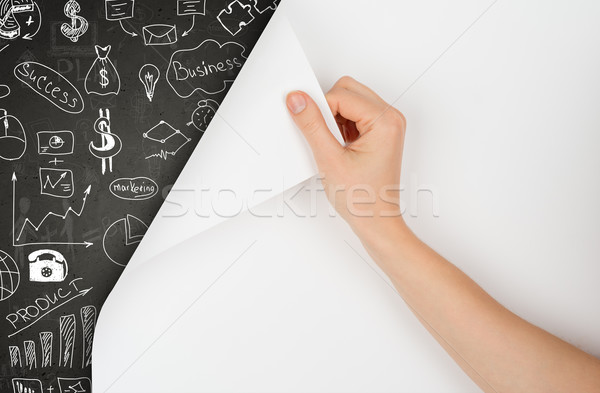 Hand turns page and drawing concept on blackboard Stock photo © cherezoff