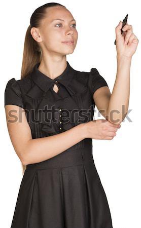 Businesswoman pointing her finger upward Stock photo © cherezoff