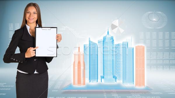 Femme d'affaires papier fil cadre gratte-ciel Photo stock © cherezoff