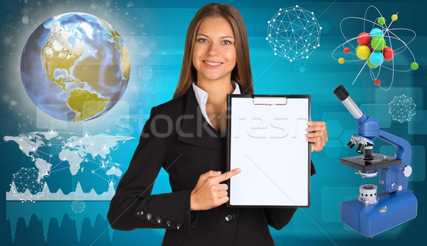 Beautiful businesswoman holding paper holder. Earth, microscope and molecule model Stock photo © cherezoff