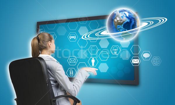 Businesswoman pressing touch screen button on virtual interface Stock photo © cherezoff