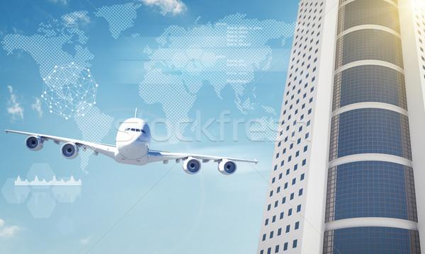 Repülőgép világtérkép felhőkarcoló kék ég város világ Stock fotó © cherezoff
