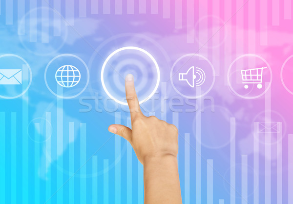 Humans hand clicking on virtual colorful screen Stock photo © cherezoff