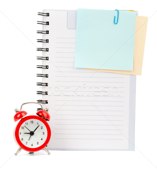 Copybook with stickers and alarm clock Stock photo © cherezoff