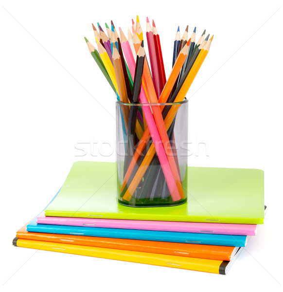 Pencil cup with crayons on copybooks Stock photo © cherezoff