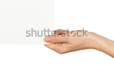 Humans right hand holding small empty card Stock photo © cherezoff