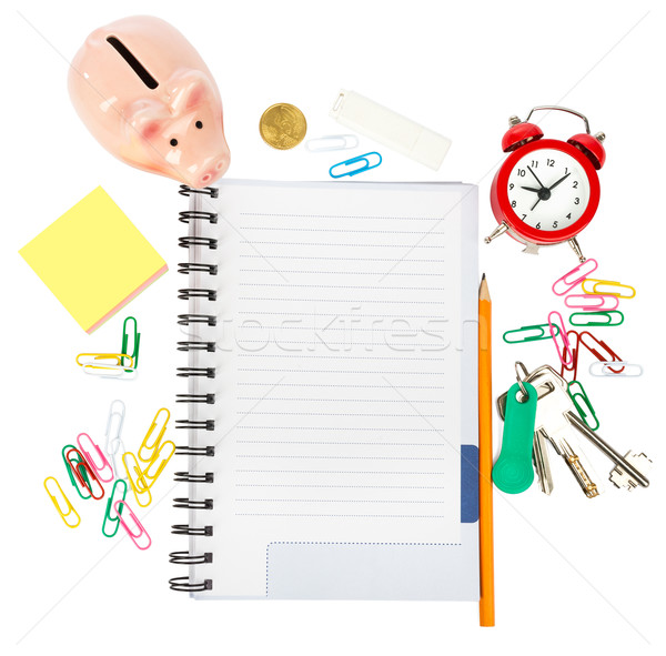 Open notebook with stationery and piggy bank Stock photo © cherezoff