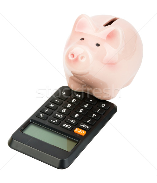 Piggy bank on calculator Stock photo © cherezoff