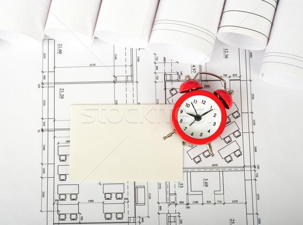 Tarjeta en blanco despertador plan superior vista edificios Foto stock © cherezoff