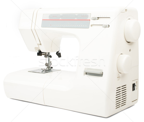 Elektryczne maszyny do szycia biały odizolowany pracy metal Zdjęcia stock © cherezoff