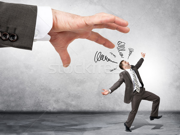 Business boss hand catching scared employee  Stock photo © cherezoff