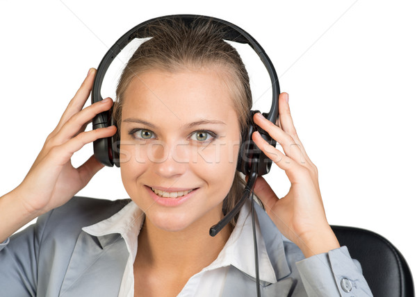 Businesswoman in headset, looking at camera Stock photo © cherezoff