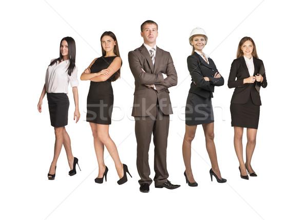 Jovem atraente pessoas de negócios olhando câmera isolado Foto stock © cherezoff