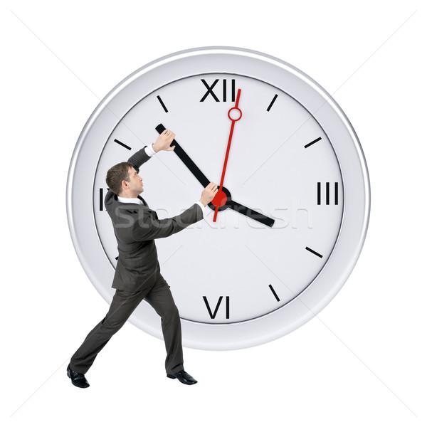 üzletember tart óramutató izolált fehér óra Stock fotó © cherezoff