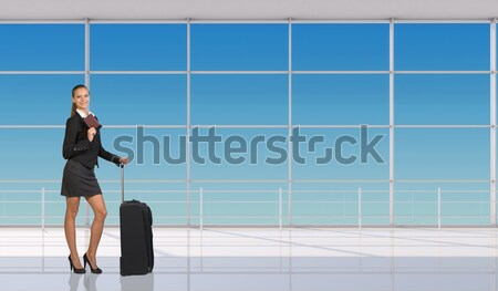 Beautiful businesswoman in dress happily raised his hands up, looking at camera. Dilapidated brick w Stock photo © cherezoff