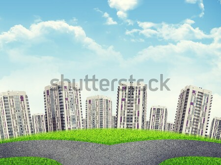 Road fork, green grass field and city. Sky with clouds Stock photo © cherezoff