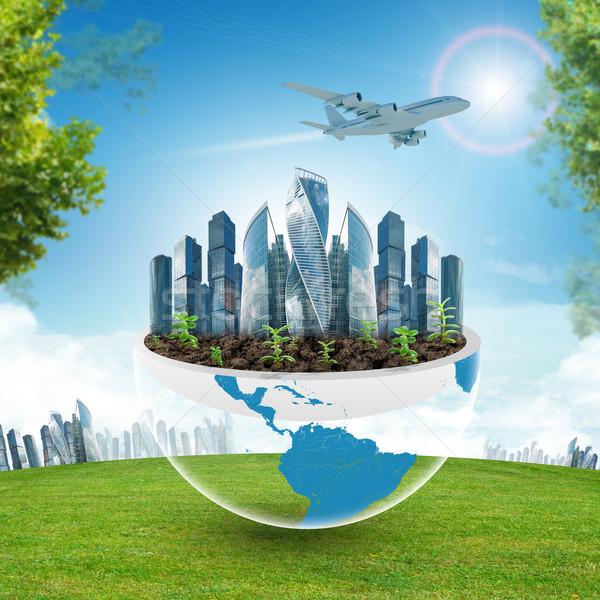 Stad half planeet groen gras blauwe hemel gras Stockfoto © cherezoff