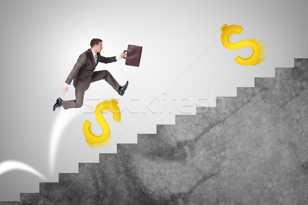 Man running up stairs with gold dollar signs Stock photo © cherezoff