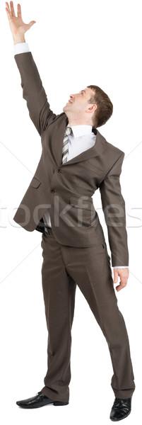 бизнесмен работает вверх изолированный белый стороны Сток-фото © cherezoff
