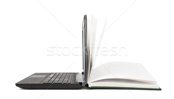 Open book turns into an open laptop Stock photo © cherezoff