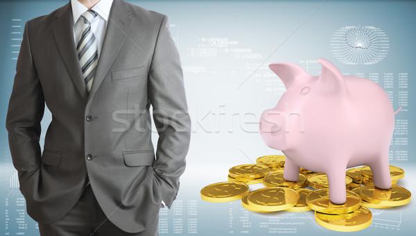üzletember persely arany érmék grafikonok munkás pénzügy Stock fotó © cherezoff