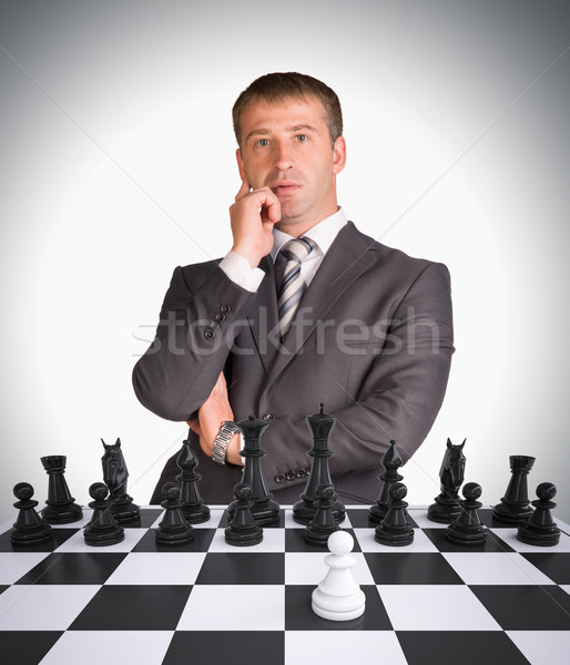 Lost in thought businessman and chess board Stock photo © cherezoff