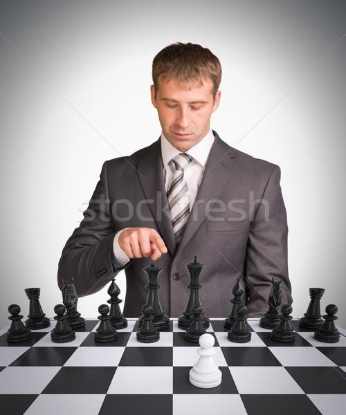 Işadamı satranç tahtası satranç gri iş el Stok fotoğraf © cherezoff