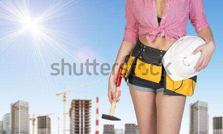 Woman in tool belt with different tools. Hands on hip Stock photo © cherezoff
